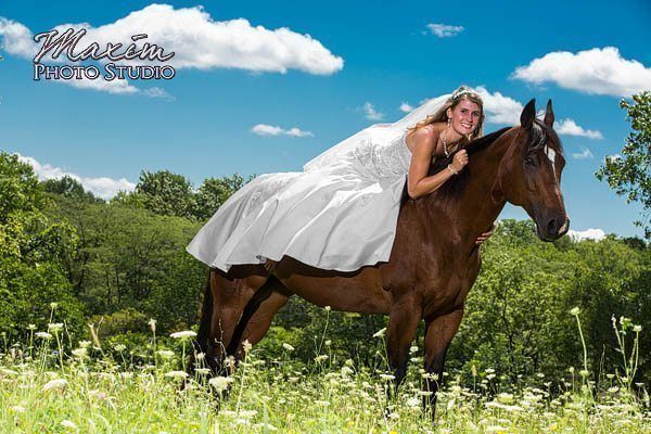 bride in wedding dress on horse
