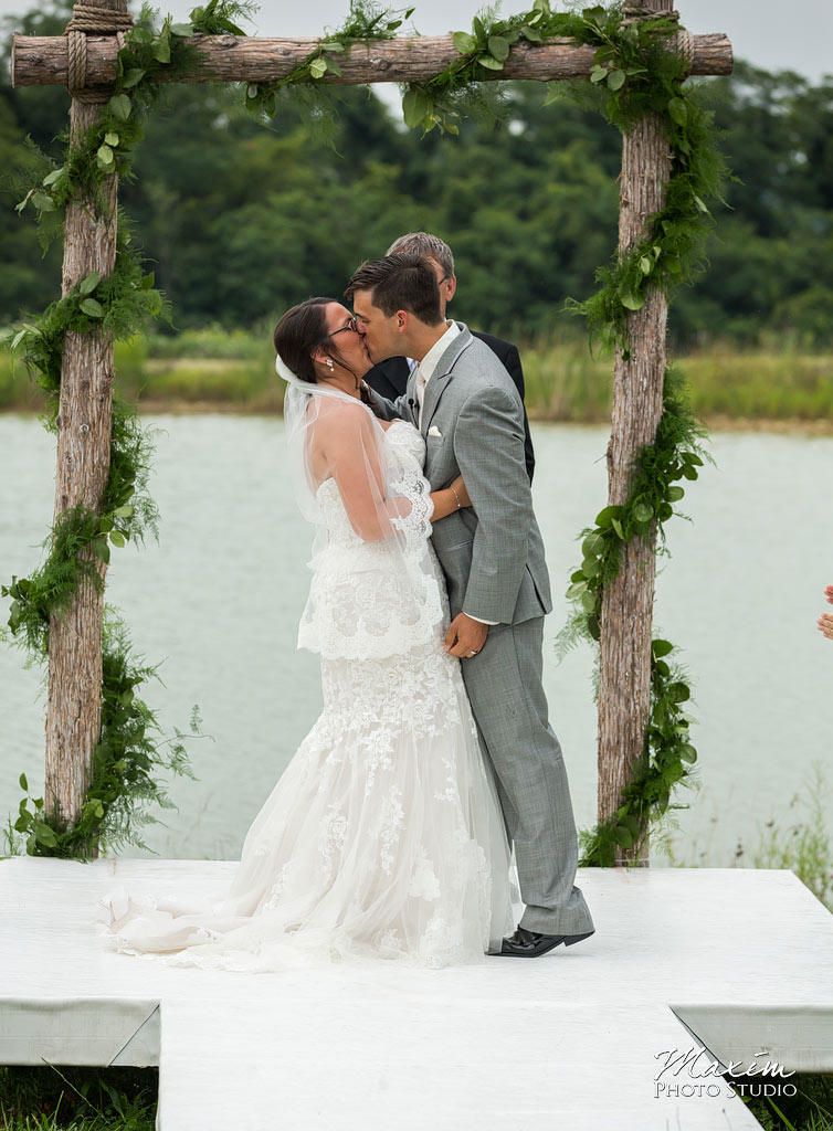 Chateau Pomije winery wedding ceremony kiss photo
