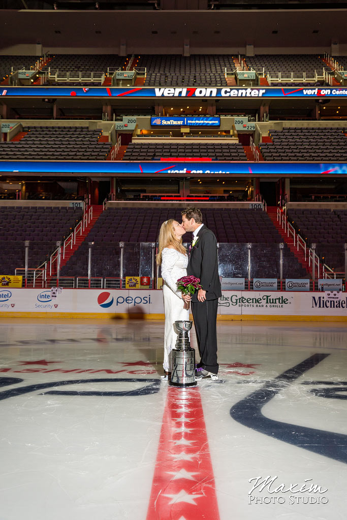 Wedding kiss at Verizon Center Stanley cup wedding