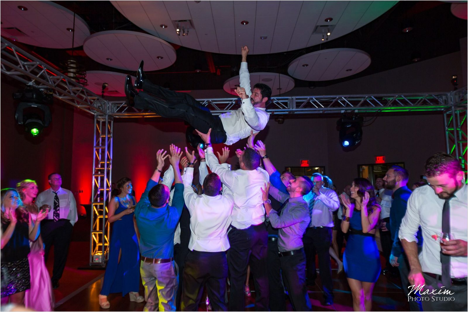 Cincinnati Wedding Photographers Sharonville Convention Center Wedding Reception Groom toss