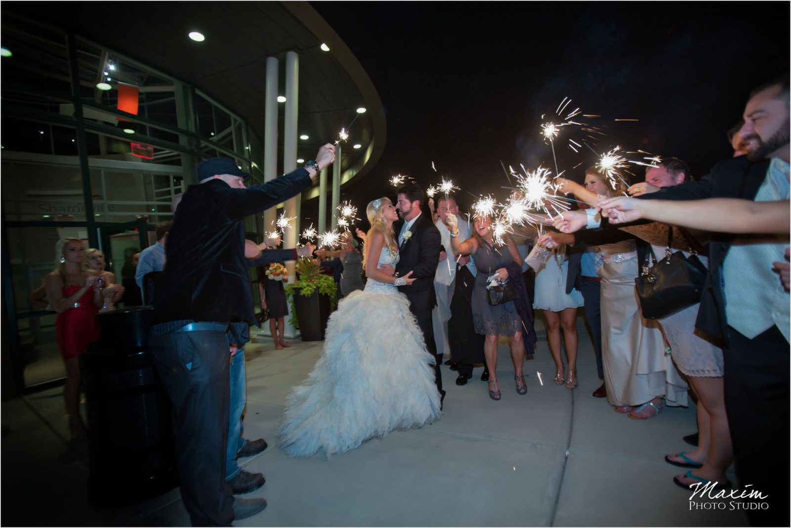 Cincinnati Wedding Photographers Sharonville Convention Center Wedding Reception sparkler exit
