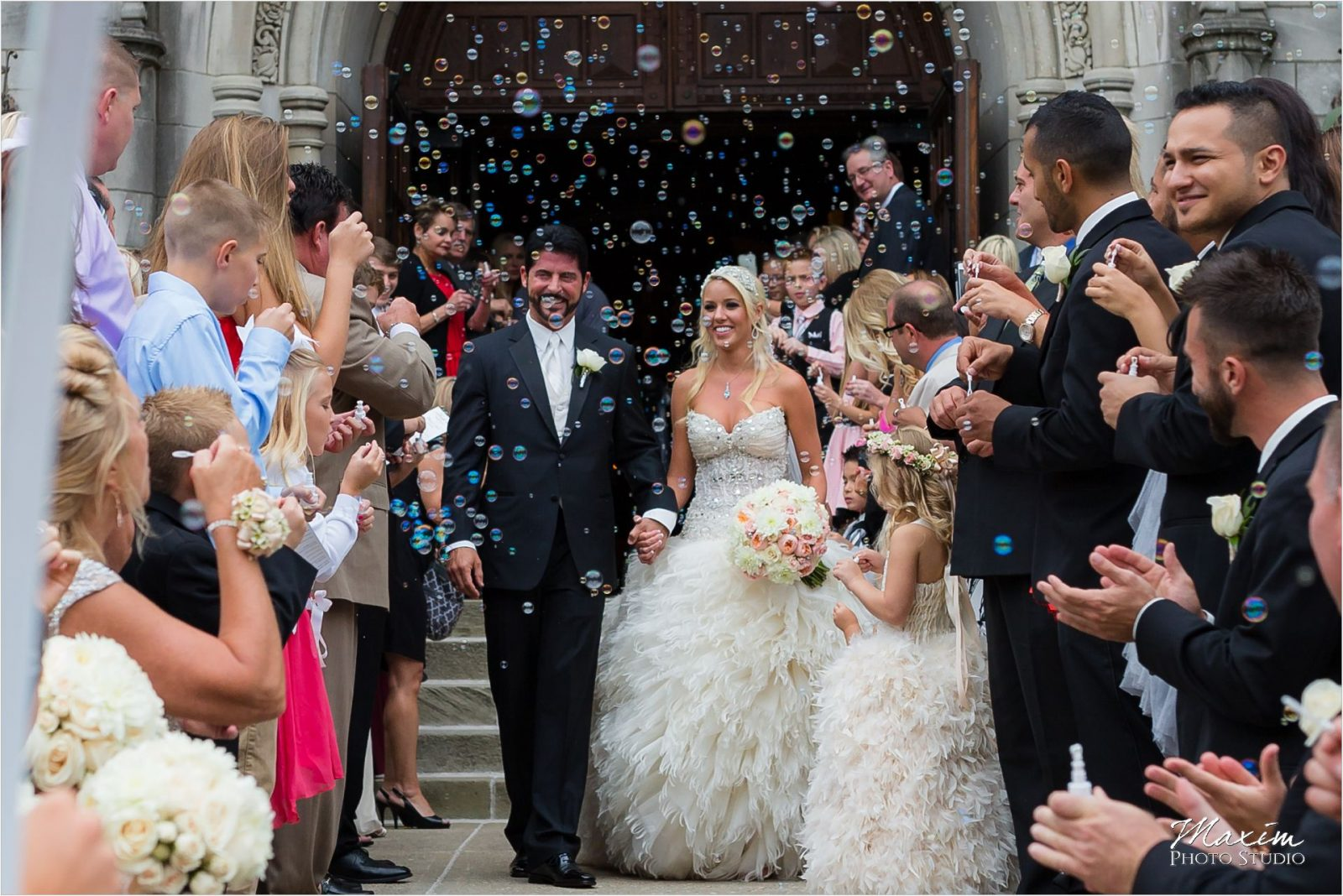 Cincinnati Wedding Photographers Hyde Park United Methodist Church Wedding bride groom bubbles