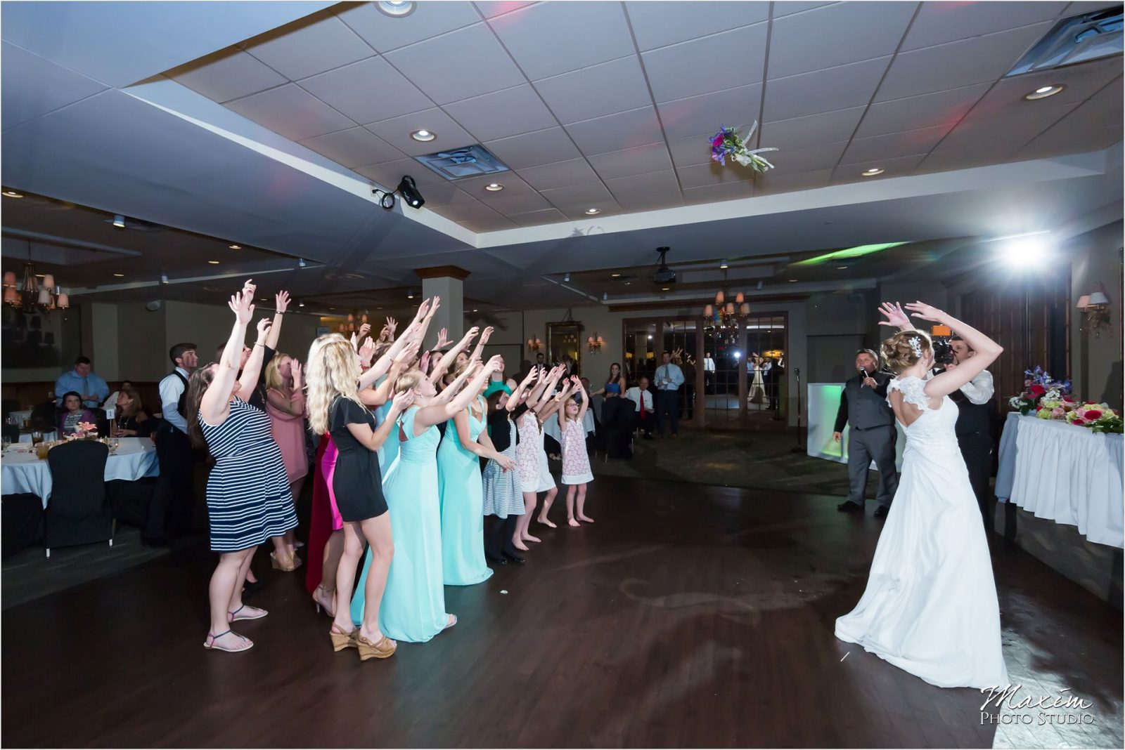 Madison Event Center Covington Kentucky Wedding Reception bouquet toss