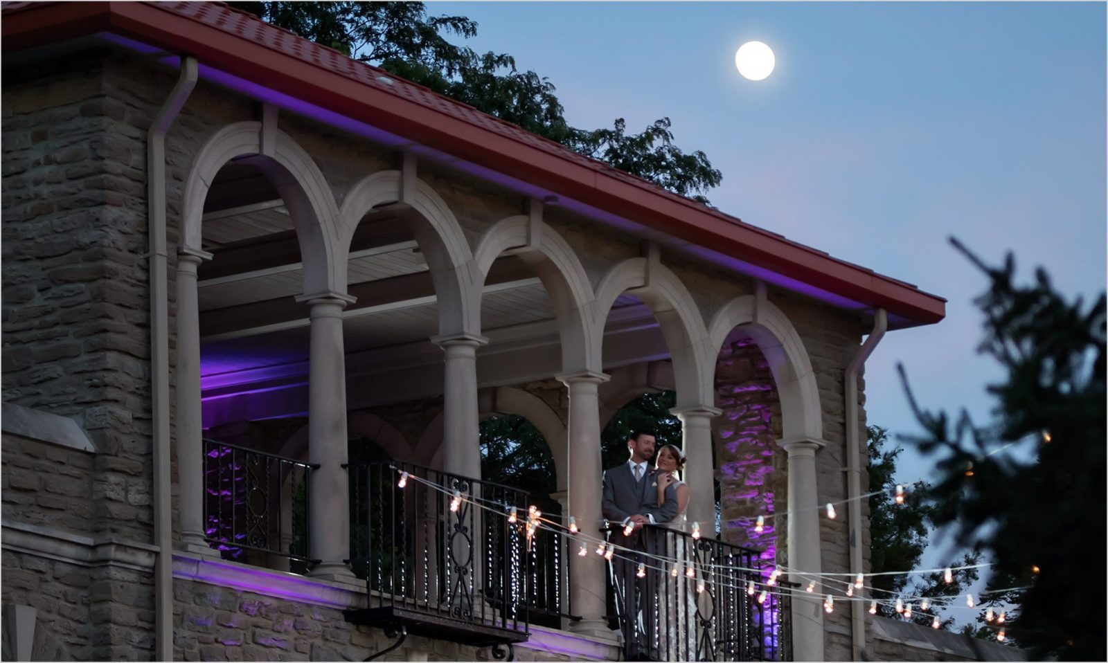 Alms Park Cincinnati Wedding Reception purple lights bride groom moonlight