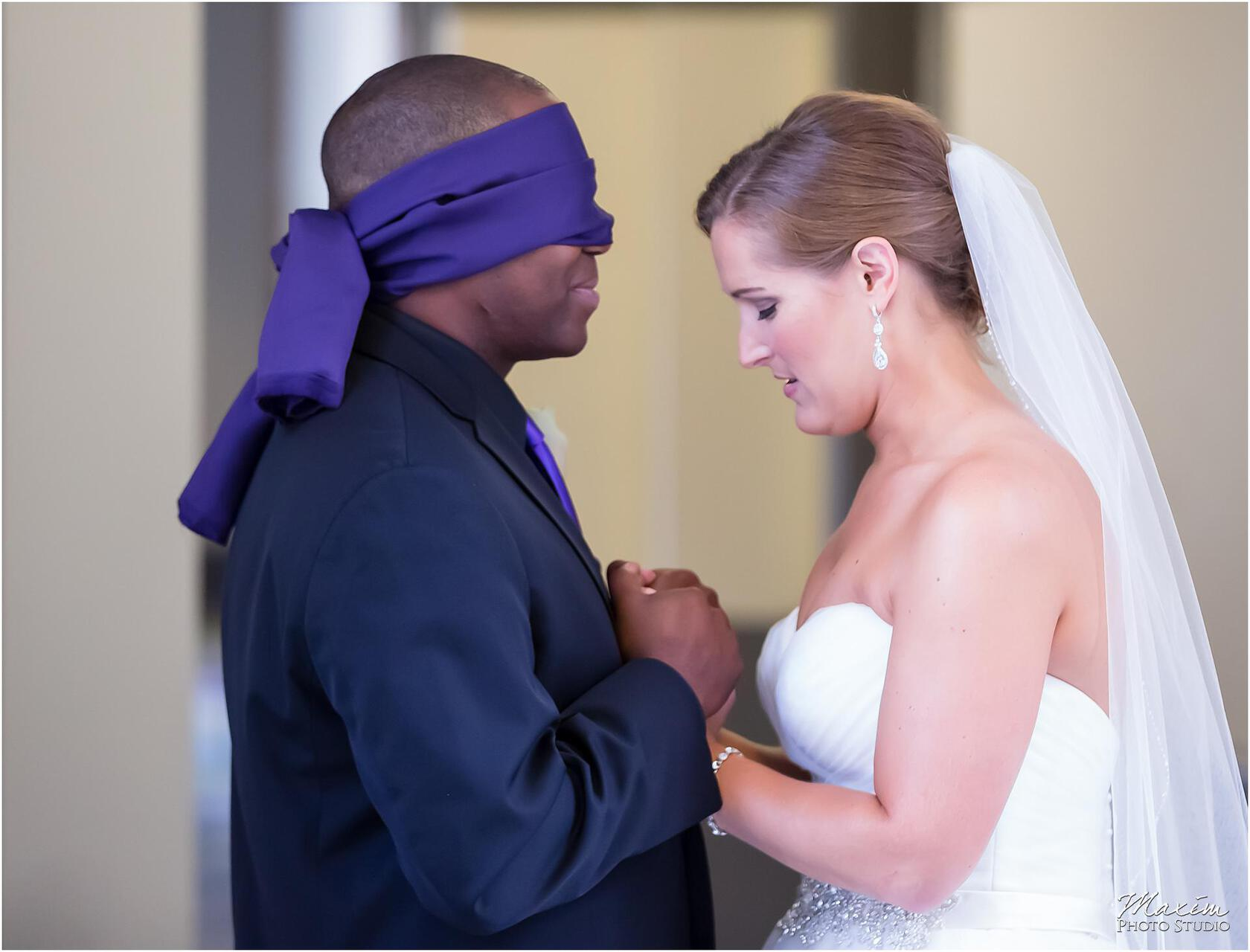 St. Aloysius Chapel Cincinnati Wedding bride groom blindfold