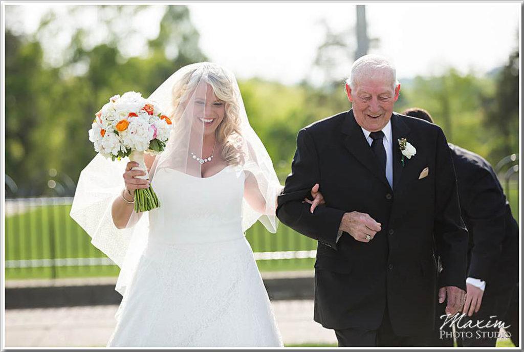 Bride walking down aisle Ault Park