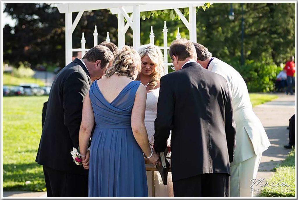Bride praying Ault Park Cincinnati