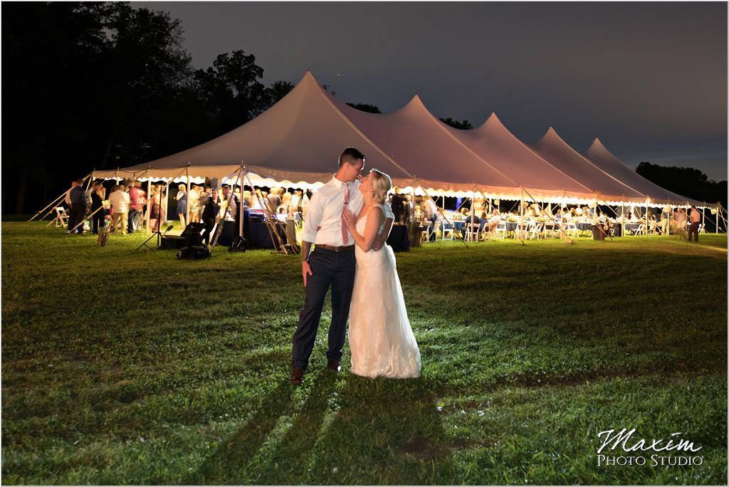 Ohio horse farm wedding tent reception bride groom night portrait
