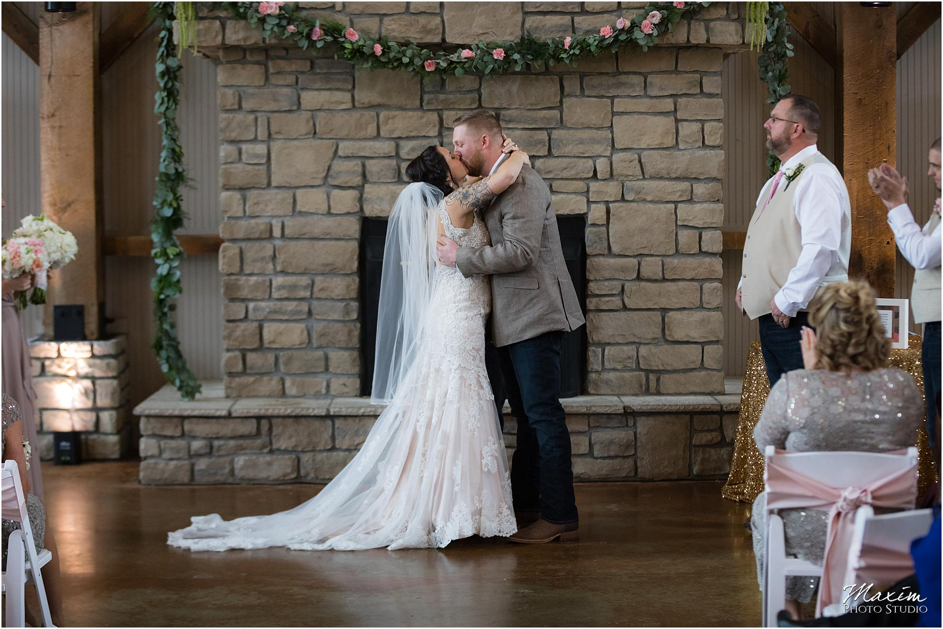 Wedding Ceremony at Muhlhauser Barn in West Chester first kiss