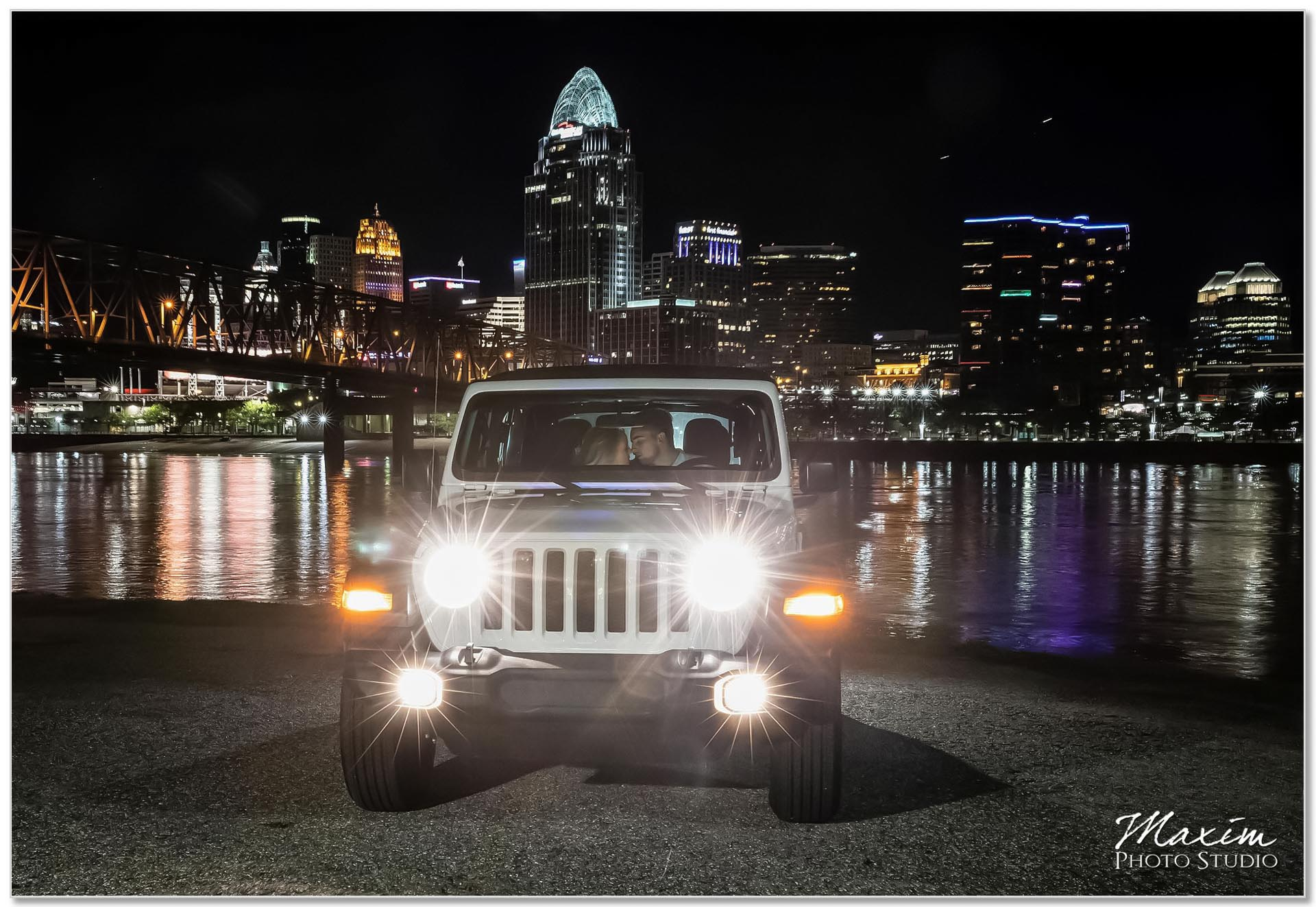 Downtown Cincinnati engagement at night Jeep Wrangler