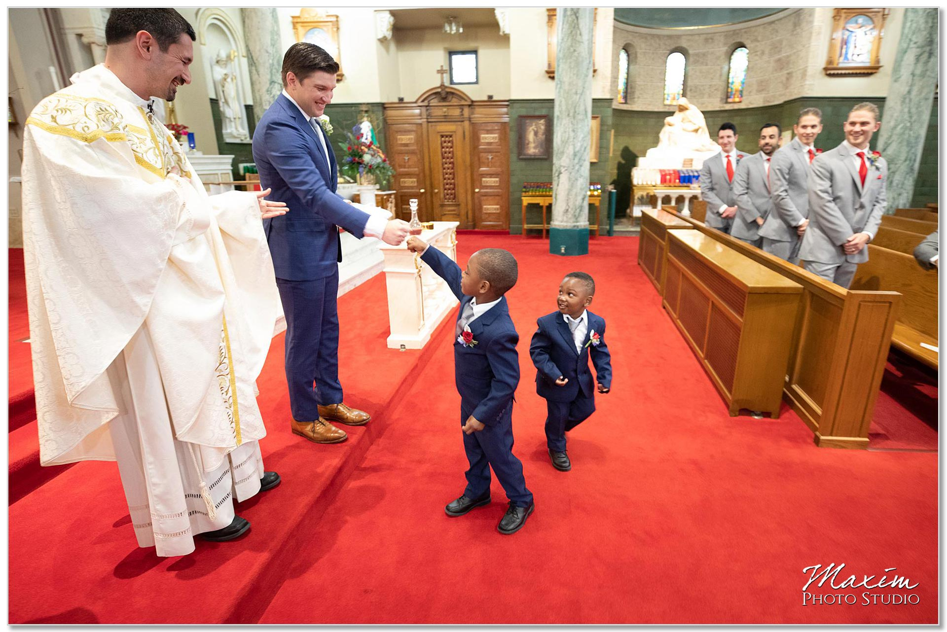 Fist pump from the ring bearers during wedding ceremony