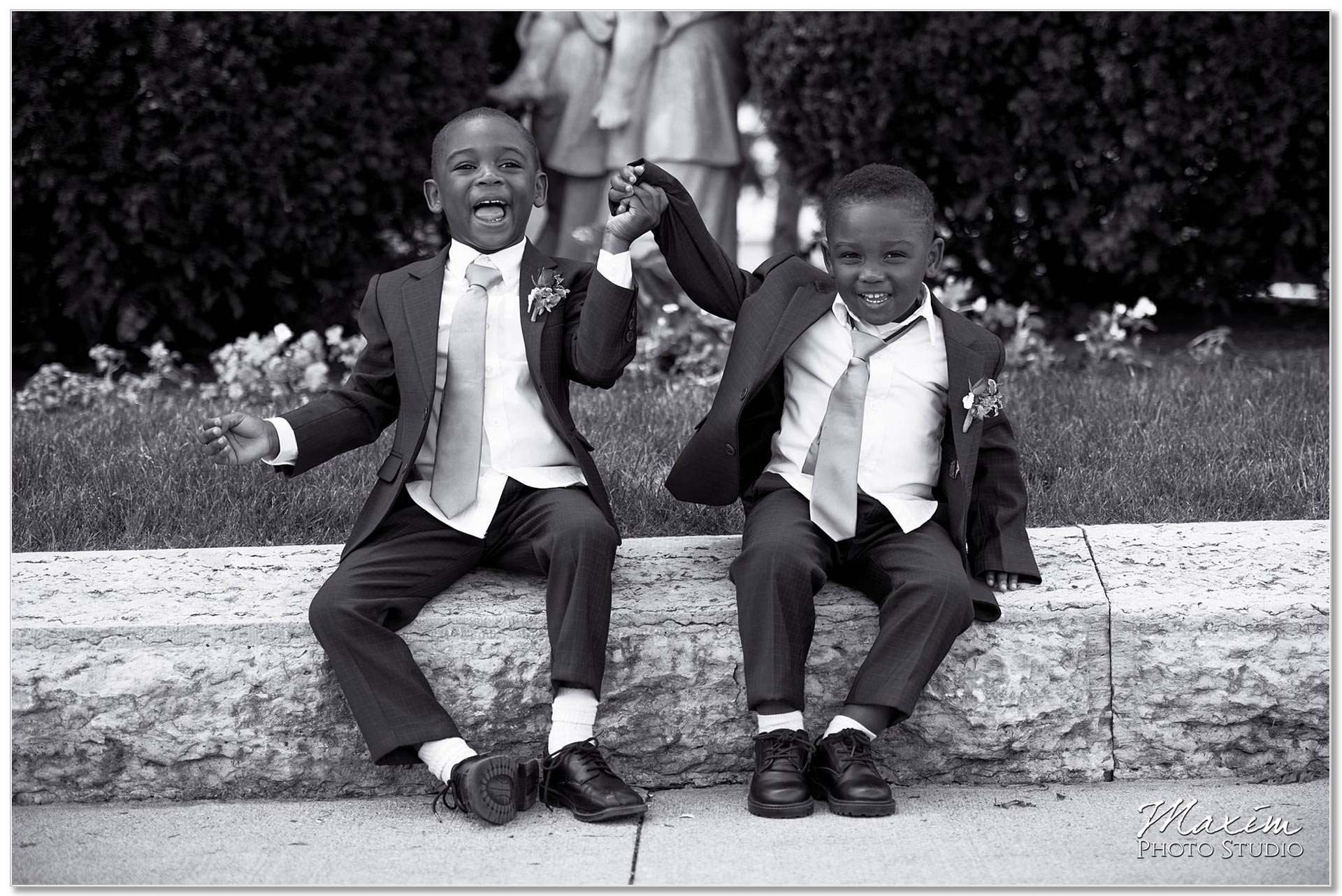 Ringbearers having wedding day fun