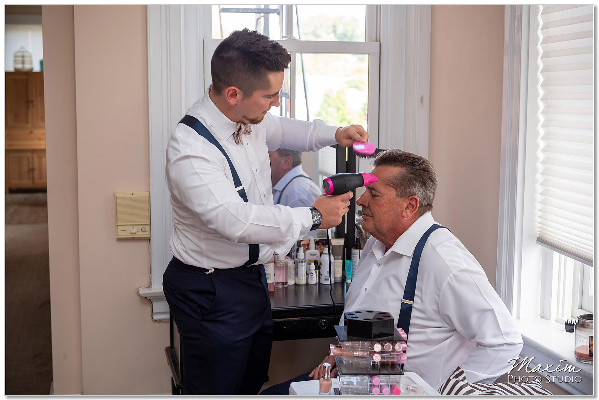 Groom preparing father's hair Cincinnati Wedding
