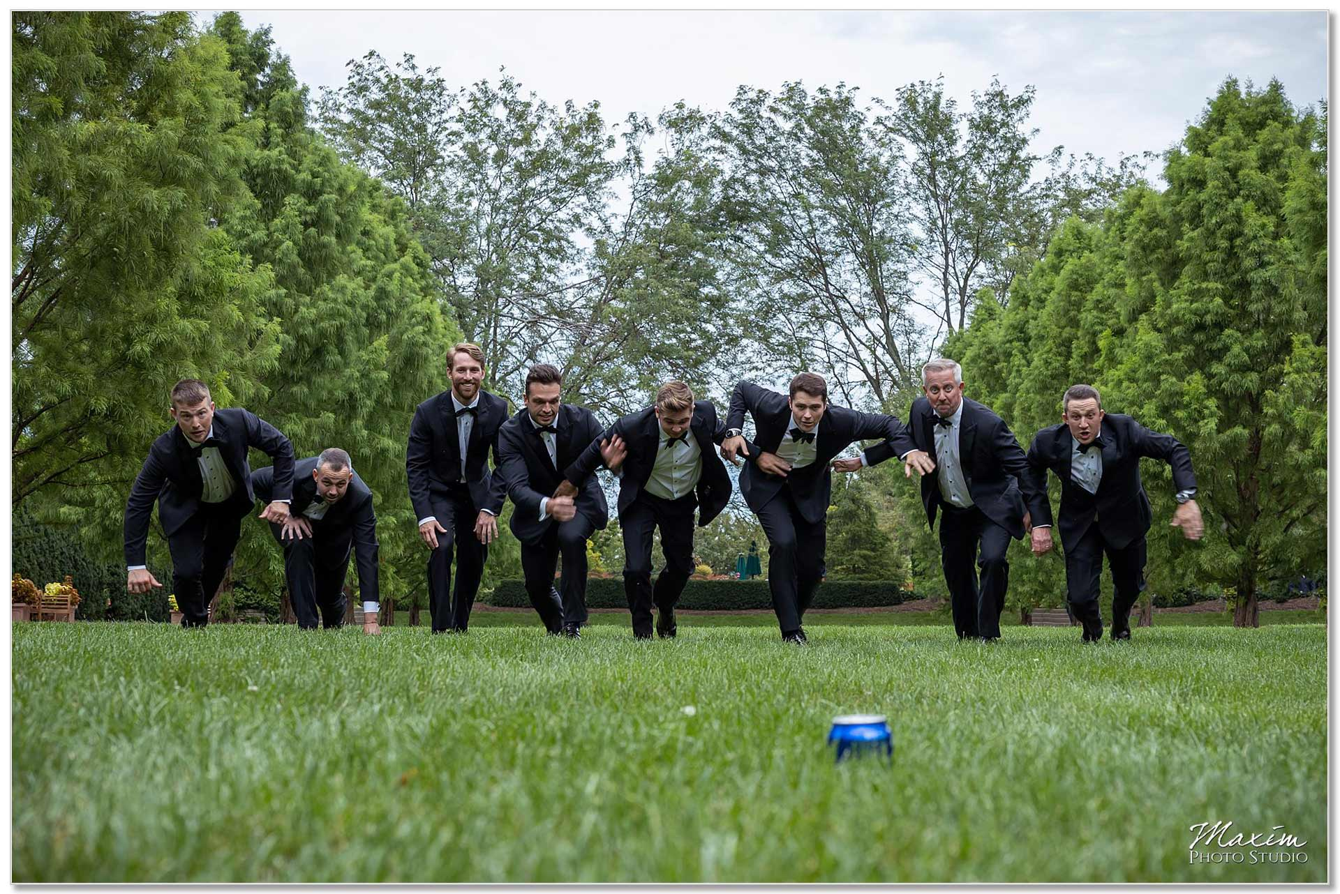Groomsmen running for beer