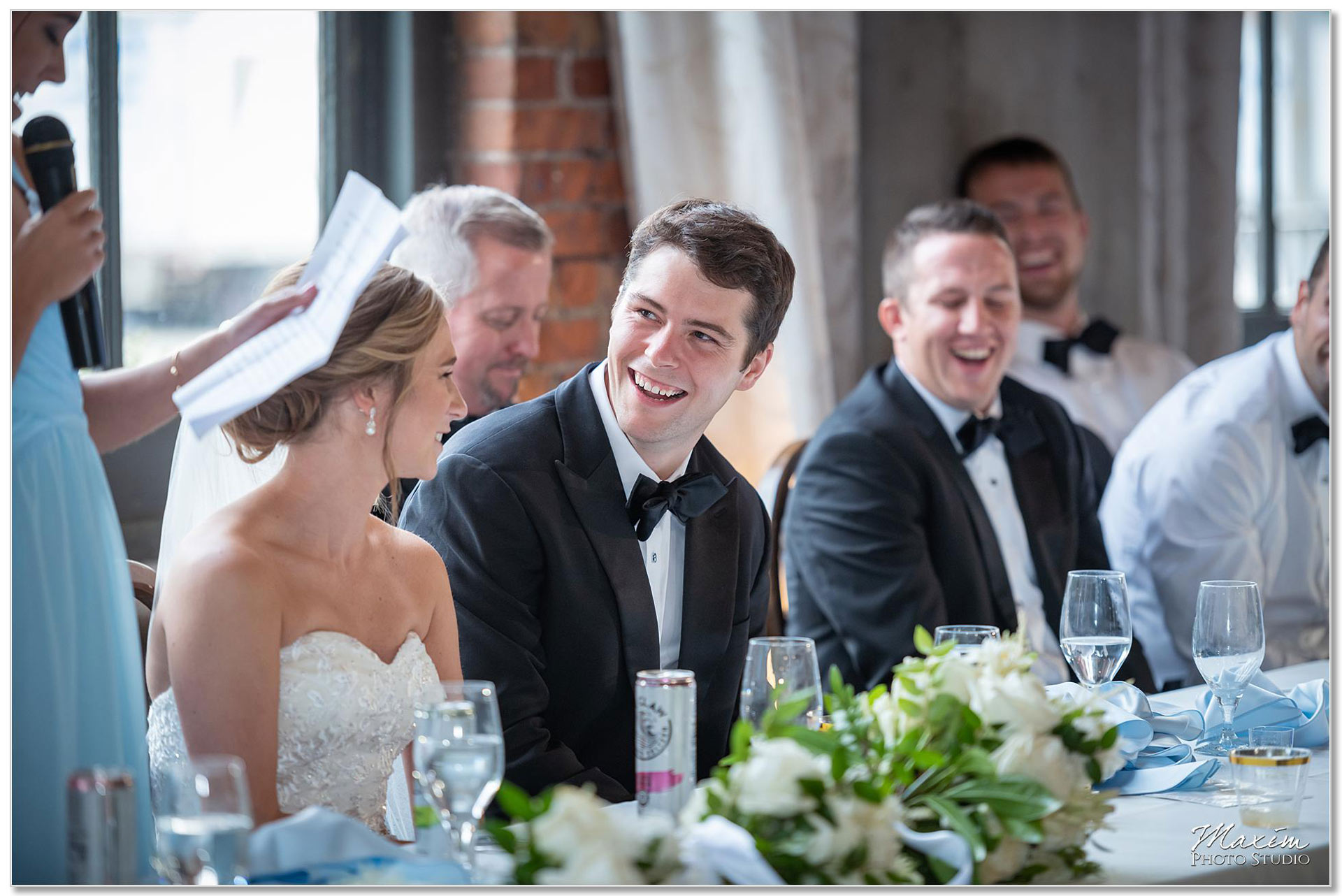bride groom laughing at The Steam Plant wedding reception