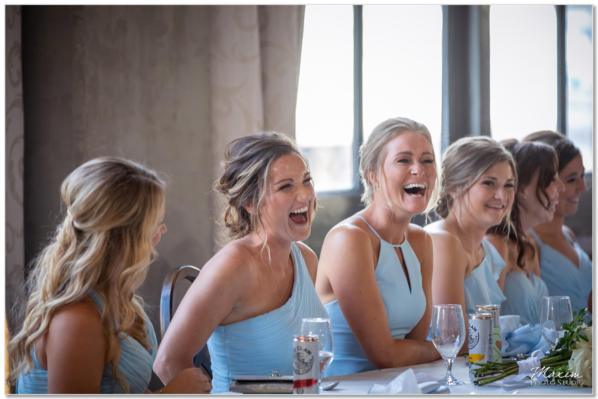 Bridesmaids laughing at The Steam Plant wedding reception