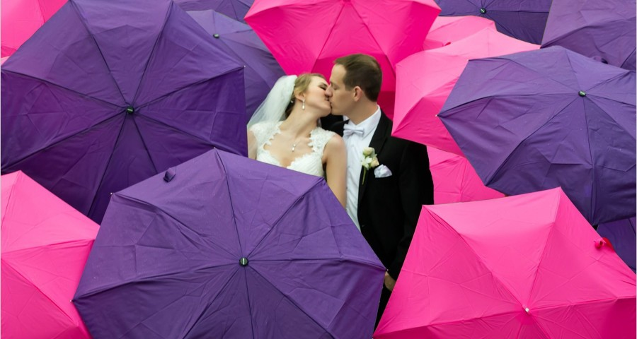 Yeatman's Cove Cincinnati Wedding bride groom rain umbrellas